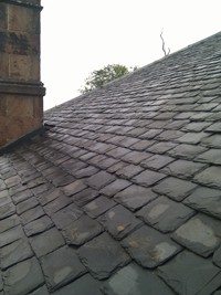Picture showing slate roof repaired by SDM