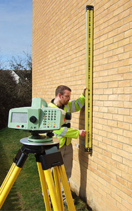 Picture of technician performing precise level monitoring survey